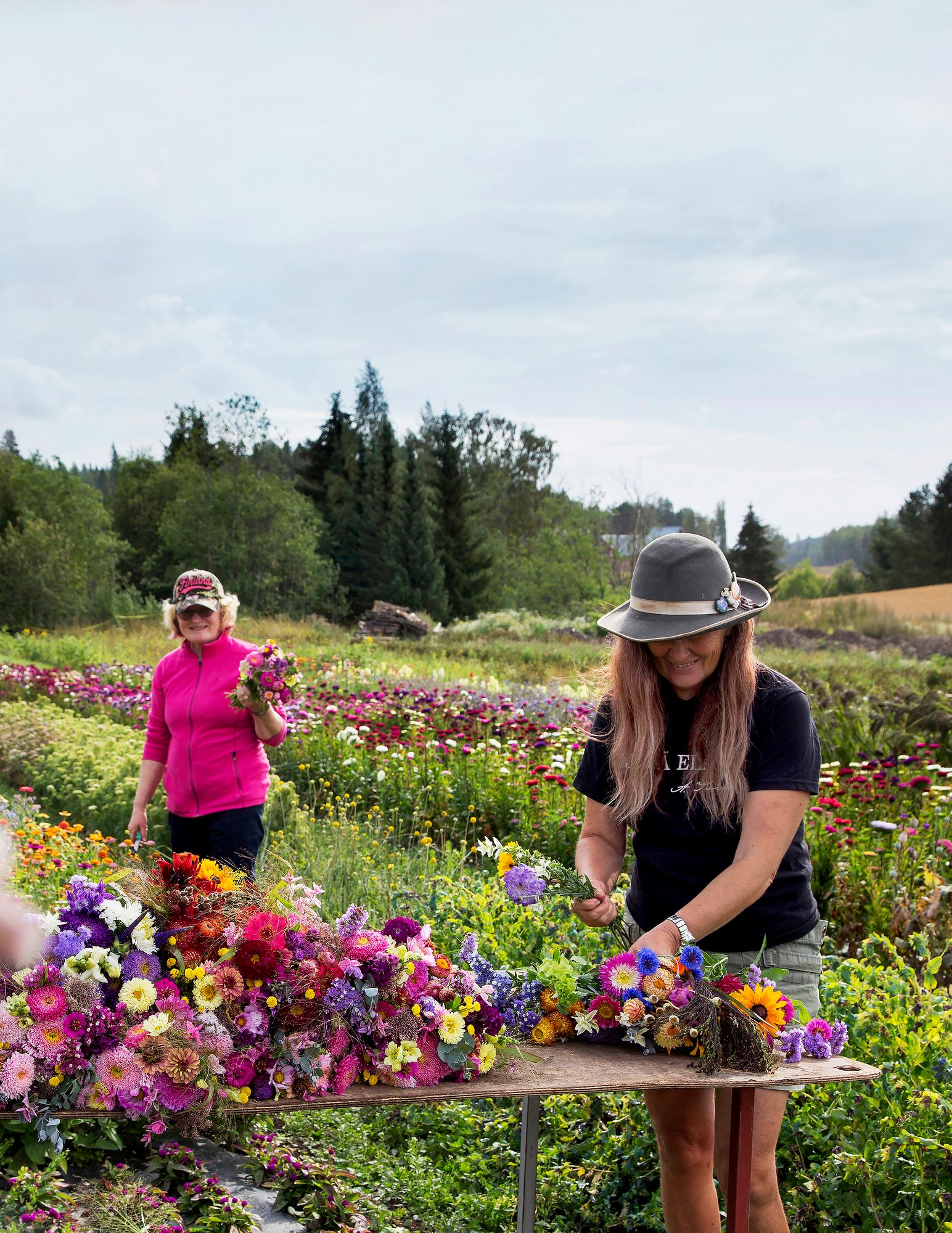 Flower field and its rulers!  Sisters Hannele (front) and Tuula Ruoti grow hundreds of different cut flowers on their home farm using the most ecological means possible.