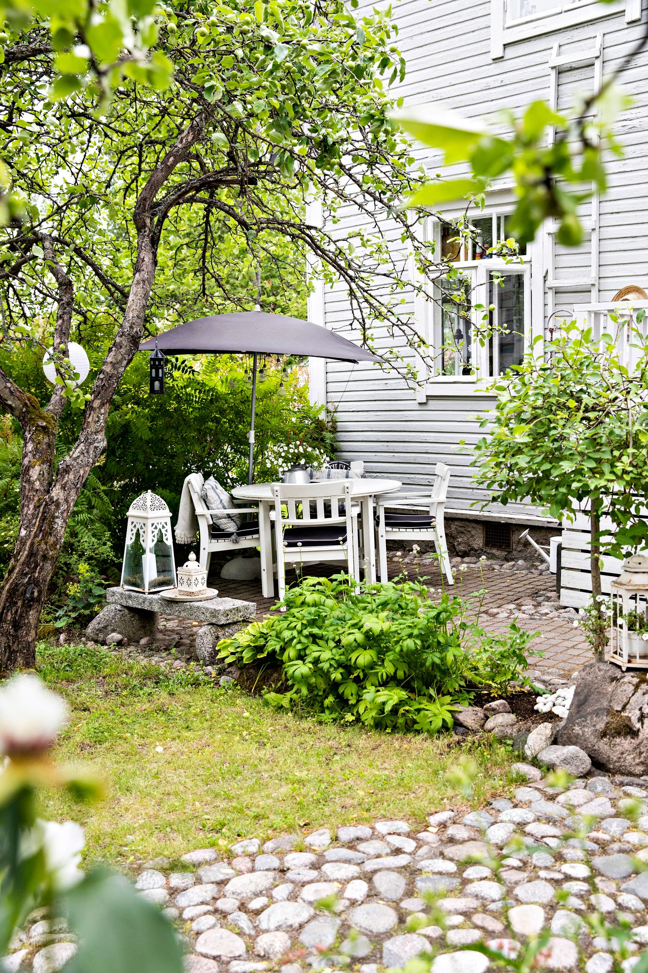 The base of the stone yard seat is concrete stone, which provides a flat and sturdy surface.  If the stone surface is bordered by a lawn, the outermost stones are bonded with a damp concrete mass that extends below the edge of the lawn.