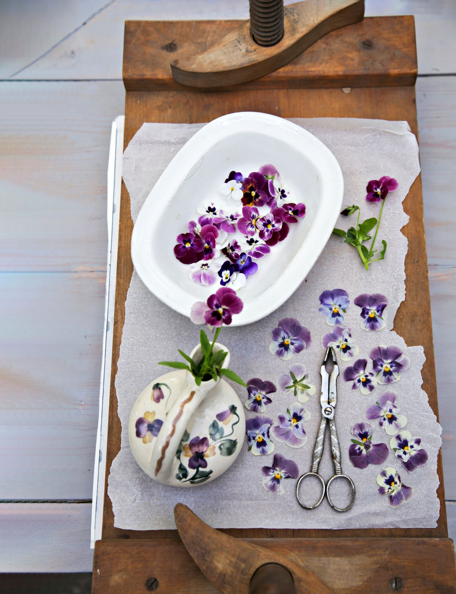 Edible flowers can be preserved for the winter season by drying them.  The most beautiful are the flowers pressed smooth under the weight between two thin papers.